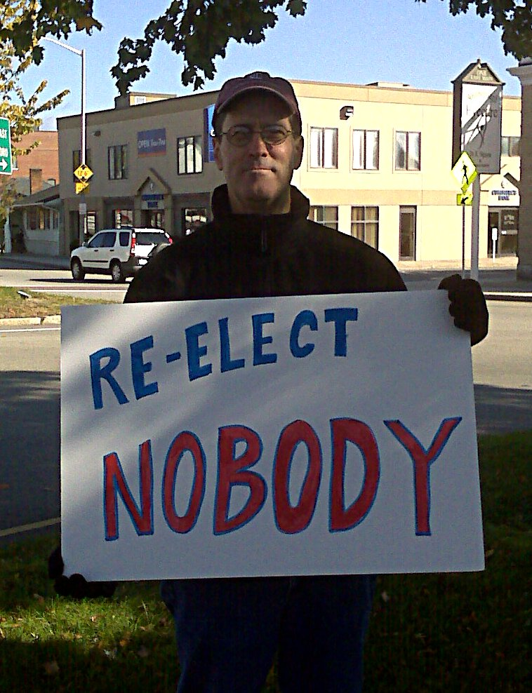 Man holding 'reelect nobody' sign at Westborough rotary Oct 23 2010